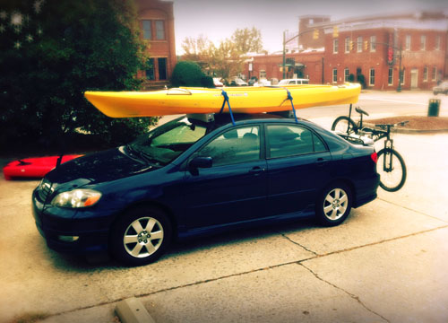 Photo of our car with kayak and mountain bike
